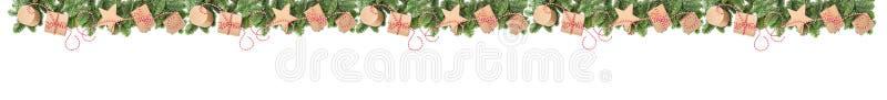 Weihnachtsdekorationsgeschenkboxen Kieferniederlassungs-Grenzfahne lizenzfreies stockbild