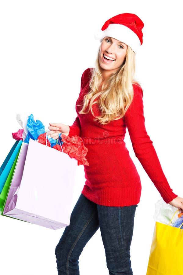 Weihnachtseinkaufen-Sankt-Mädchen lizenzfreie stockfotos