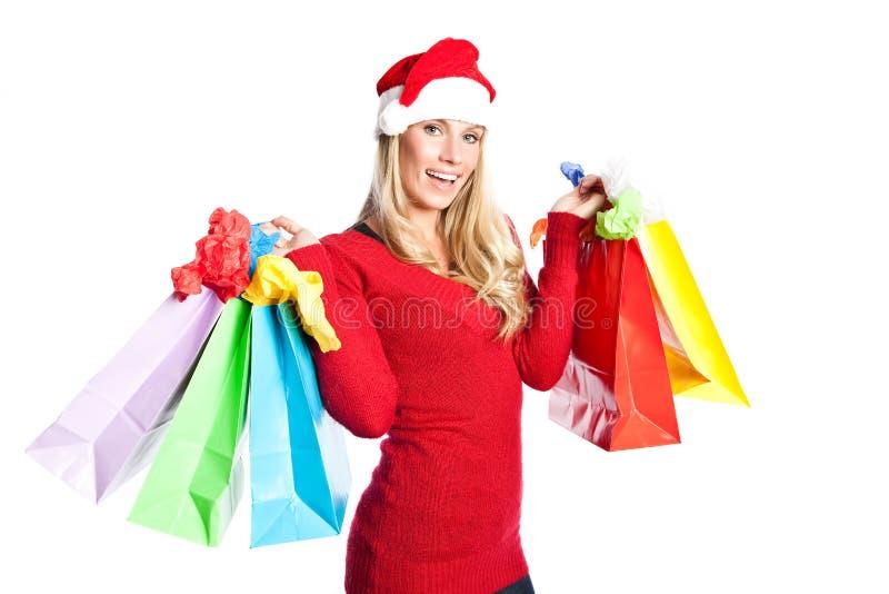 Weihnachtseinkaufen-Sankt-Mädchen stockbild