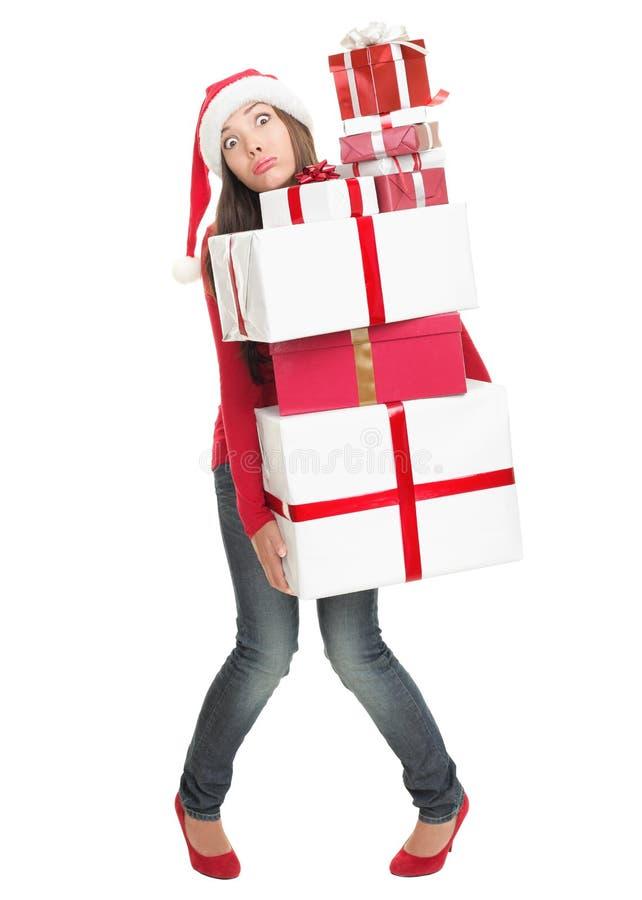 Weihnachtsfrau ermüdet mit vielen Geschenken lizenzfreie stockfotos