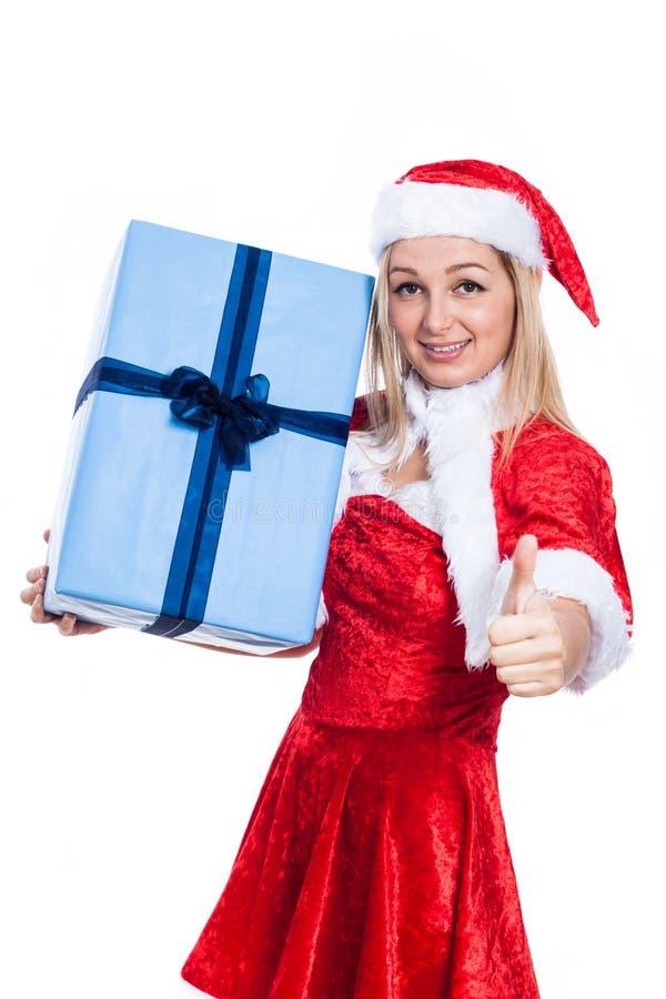 Weihnachtsfrau mit den anwesenden Daumen oben stockfoto