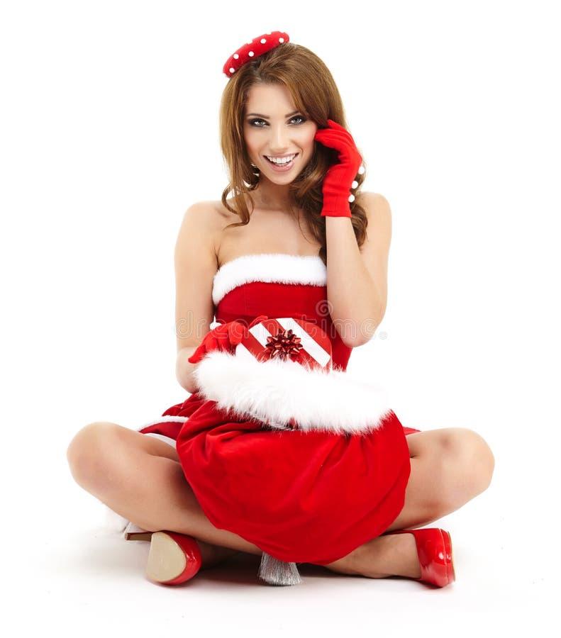 Weihnachtsfrau mit Geschenk stockbilder