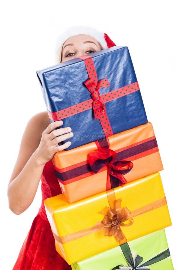 Weihnachtsfrau mit vielen stellt sich dar lizenzfreie stockfotos