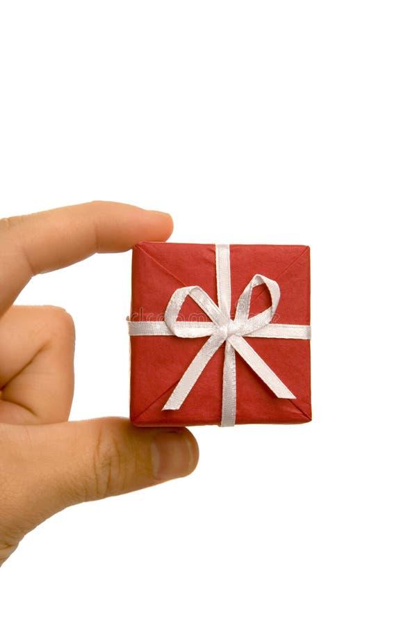 Weihnachtsgeschenk in der Hand stockbilder