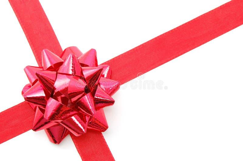 Weihnachtsgeschenk mit Farbband stockbild