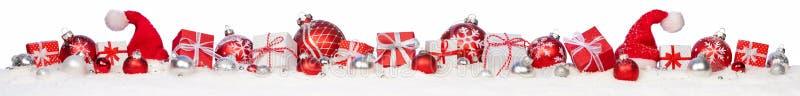 Weihnachtsgeschenke und -flitter stockbild