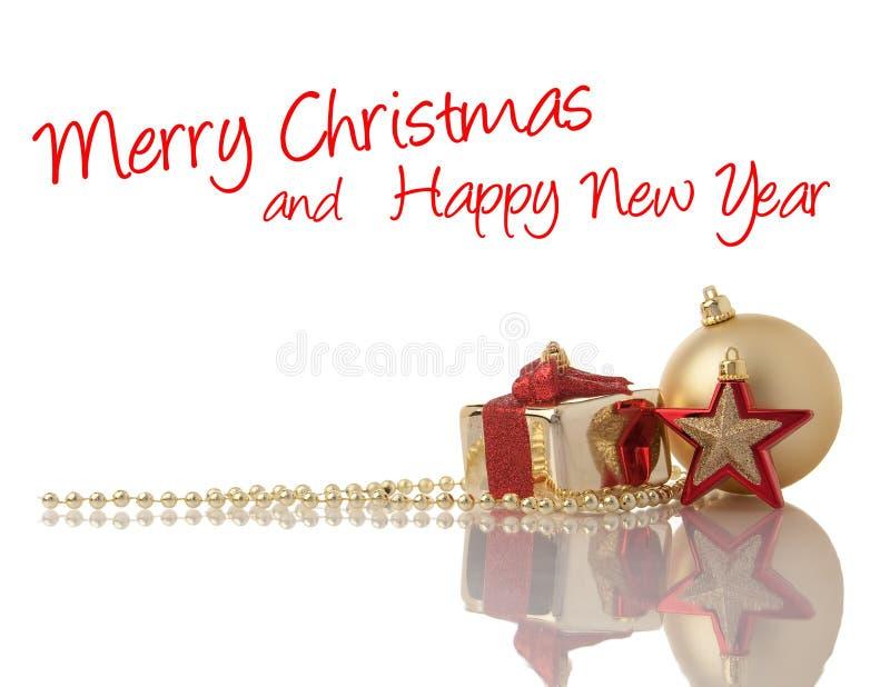 Weihnachtsgold und rote Dekorationen lizenzfreie stockfotos
