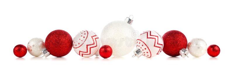 Weihnachtsgrenze von den roten und weißen Dekorationen lokalisiert auf Weiß stockfotografie
