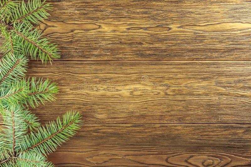 Weihnachtshölzerner Hintergrund mit Tannenrahmen Setzen Sie La Ihres Textes stockfotos