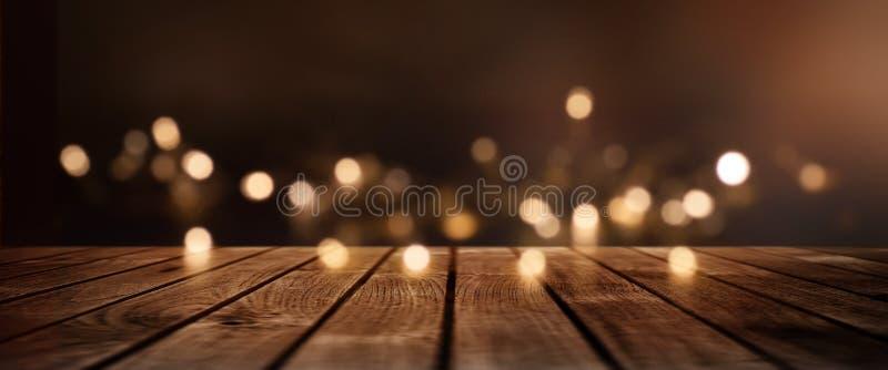 Weihnachtshintergrund mit goldenen Lichtern für eine Dekoration stockfotos