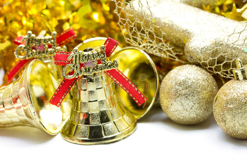 Weihnachtshintergrund mit Verzierung der goldenen Glocke lizenzfreie stockbilder