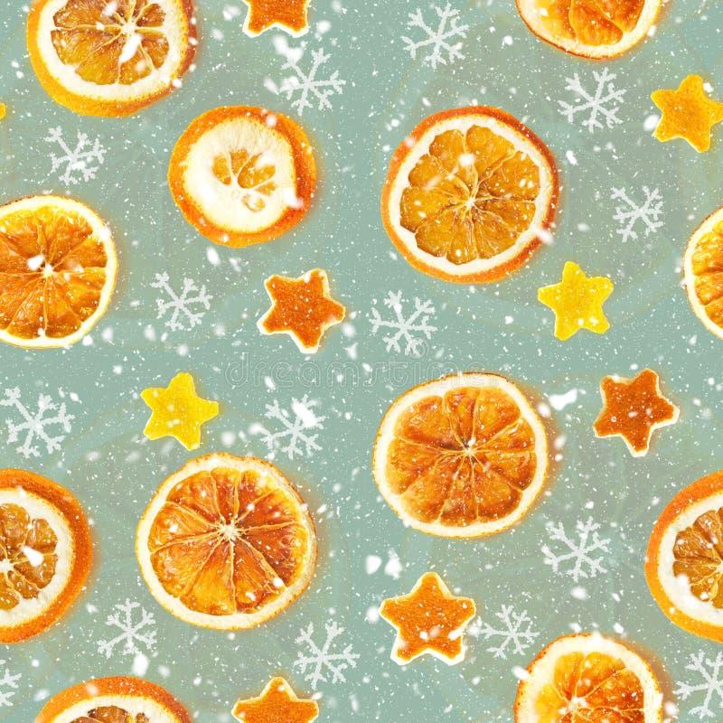 Weihnachtshintergrund von getrockneten Orangen, Schale in Form eines Sternes Nahtloser Hintergrund lizenzfreie stockfotos