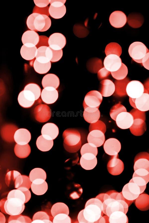 Weihnachtshintergrund, Weihnachtslichter, rotes bokeh stockfoto