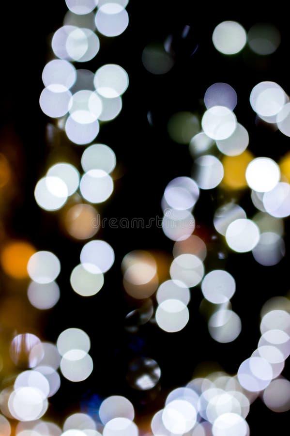 Weihnachtshintergrund, Weihnachtslichter, weißes bokeh lizenzfreie stockbilder