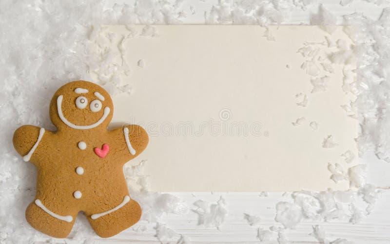 Weihnachtskarte mit dem Lebkuchenmann lizenzfreies stockbild