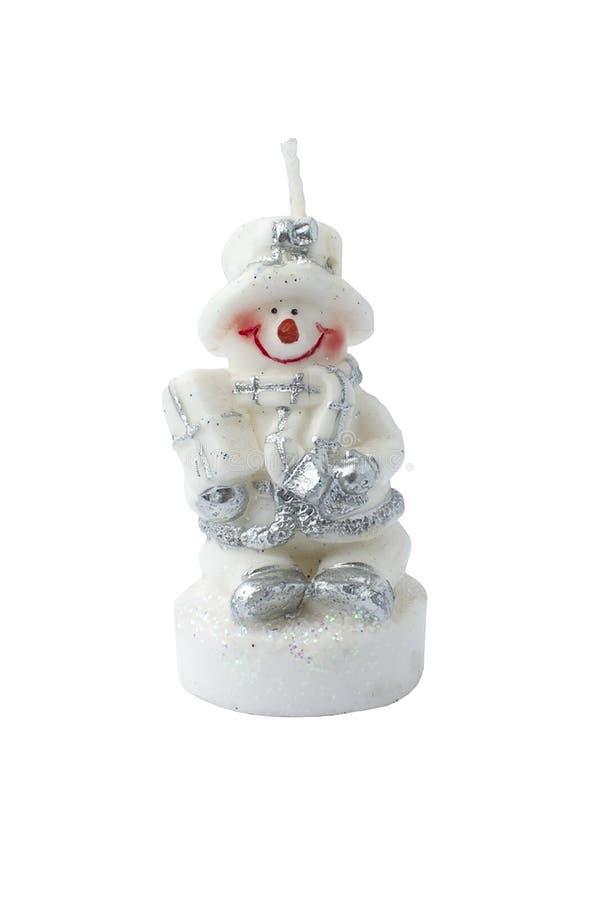 Weihnachtskerze in Form eines Schneemannes auf einem weißen Hintergrund lizenzfreie stockfotos
