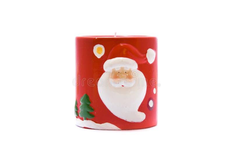 Weihnachtskerze mit Weihnachtsmann lizenzfreie stockfotografie
