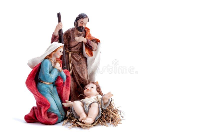 Weihnachtskrippe mit der heiligen Familie, lokalisiert auf weißem Hintergrund lizenzfreie stockbilder