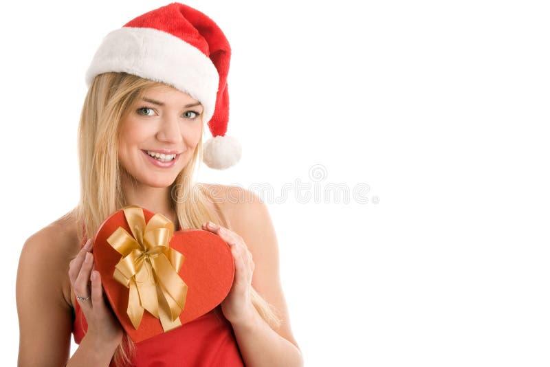 Weihnachtsmädchen mit Geschenk lizenzfreie stockfotos