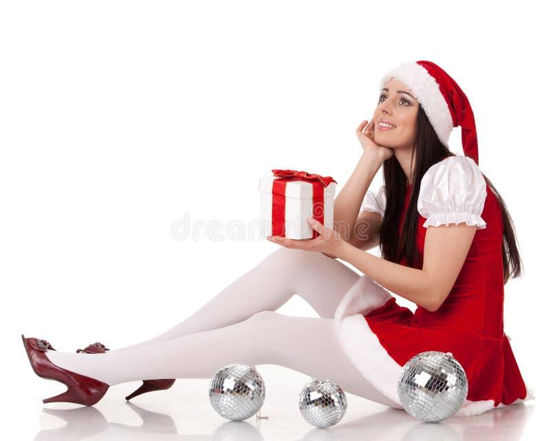 Weihnachtsmädchen mit Geschenk. stockfoto