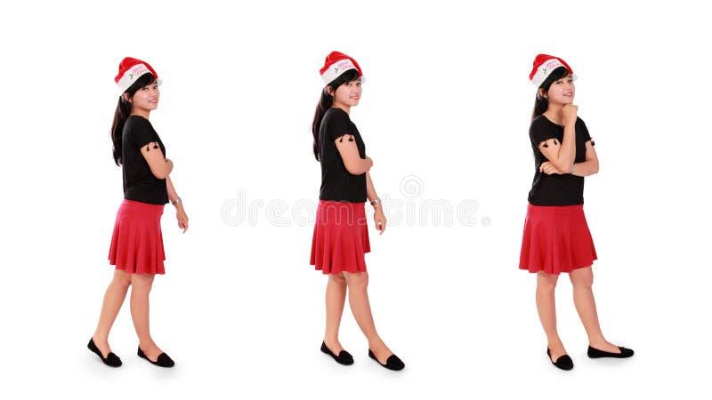 Weihnachtsmädchen-Stellungshaltungen lizenzfreies stockfoto
