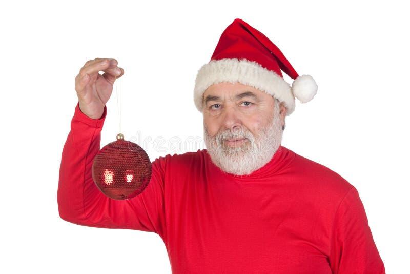 Weihnachtsmann, der eine helle Kugel von Weihnachten anhält stockfotos