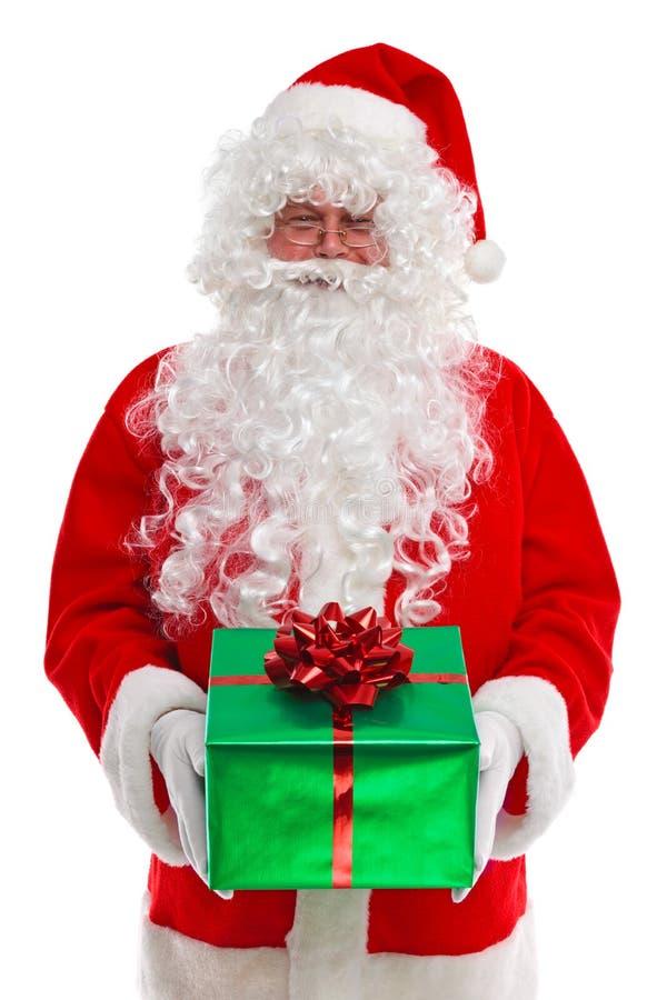 Weihnachtsmann, der Ihnen ein Geschenk gibt stockfotografie