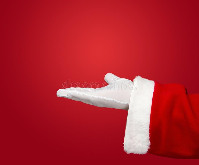 Weihnachtsmann-geöffnete Hand lizenzfreie stockbilder