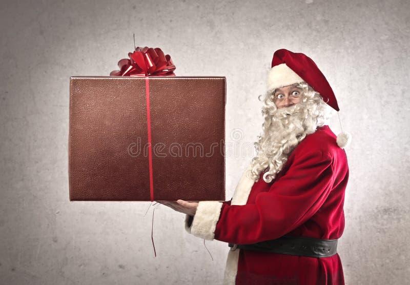 Weihnachtsmann-großes Geschenk stockfotografie