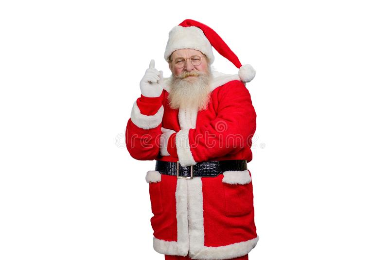 Weihnachtsmann hob Zeigefinger an stockbilder