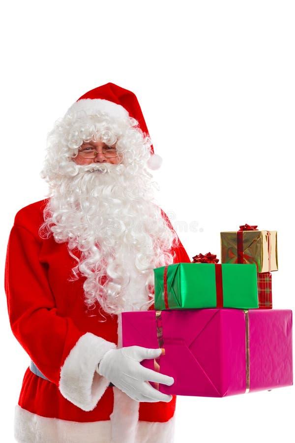 Weihnachtsmann-Holdinggeschenke. stockbilder