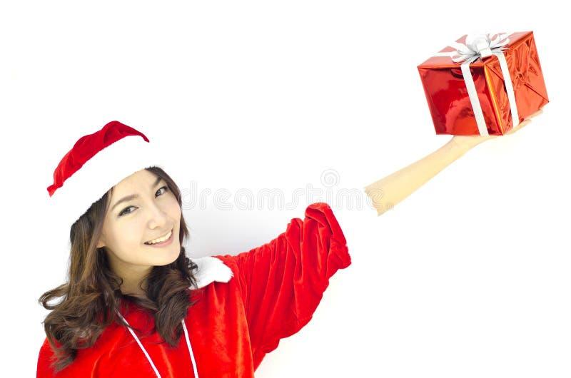 Weihnachtsmann-Hut mit grauem Weihnachtsgeschenkkasten stockfotografie