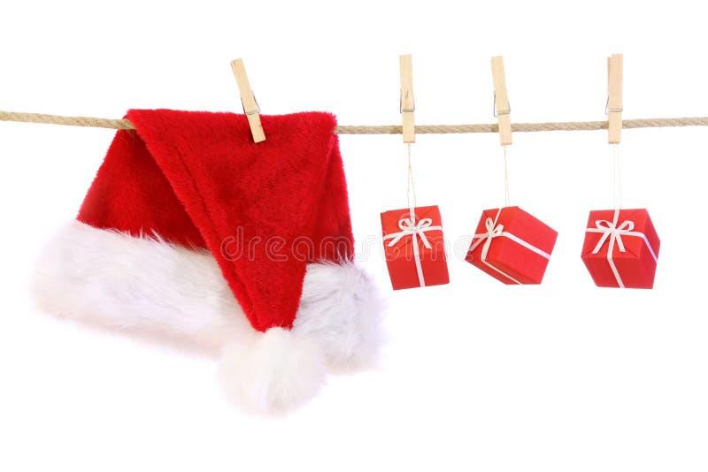 Weihnachtsmann-Hut und Geschenke stockfoto