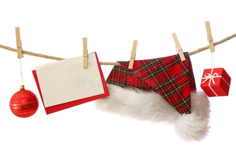 Weihnachtsmann-Hut und Geschenke stockbild