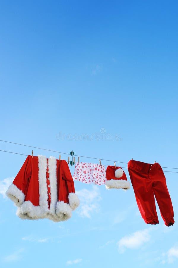 weihnachtsmann kleidung auf zeile stockbild bild von schutzkappe clear 3667421. Black Bedroom Furniture Sets. Home Design Ideas