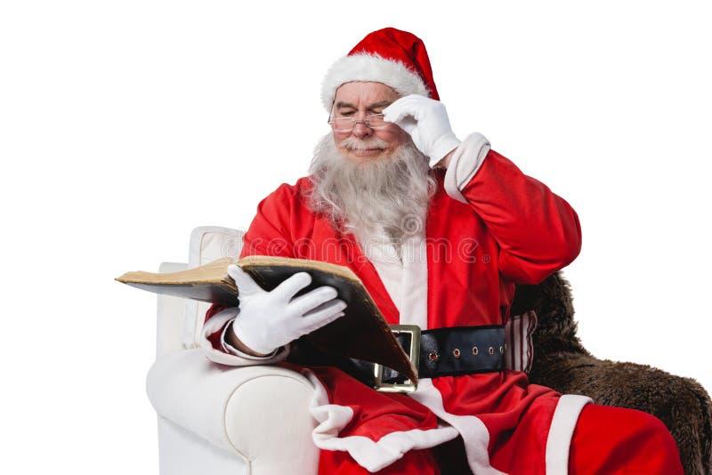 Weihnachtsmann-Lesebibel lizenzfreie stockbilder