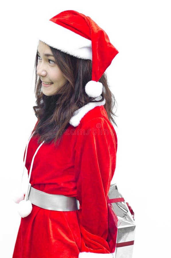 Weihnachtsmann-Mädchen mit Geschenkkasten stockfotos