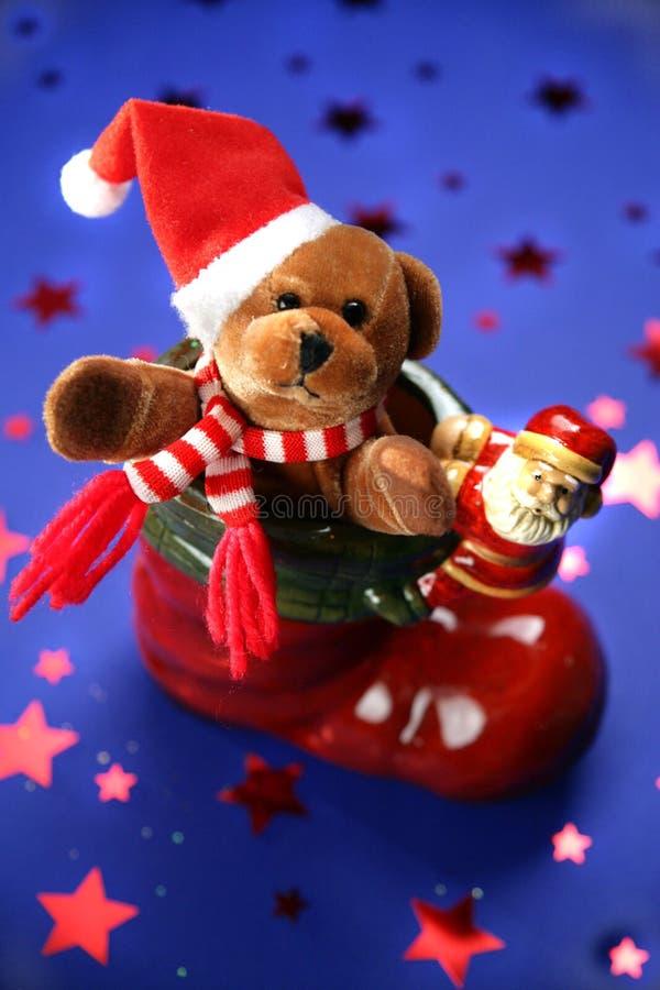 Weihnachtsmann-Matte mit festlichem Teddybären lizenzfreies stockbild