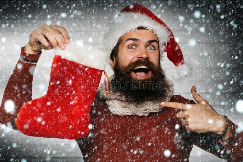 Weihnachtsmann mit dekorativem Strumpf stockfotos