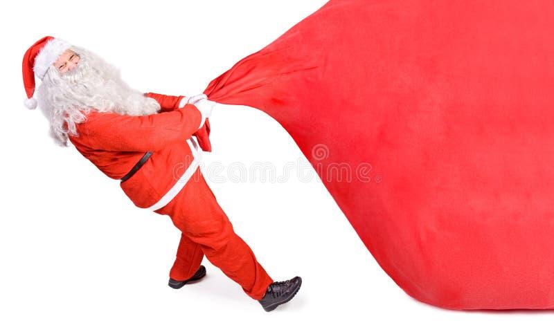 Weihnachtsmann mit einem großen Beutel lizenzfreie stockfotografie