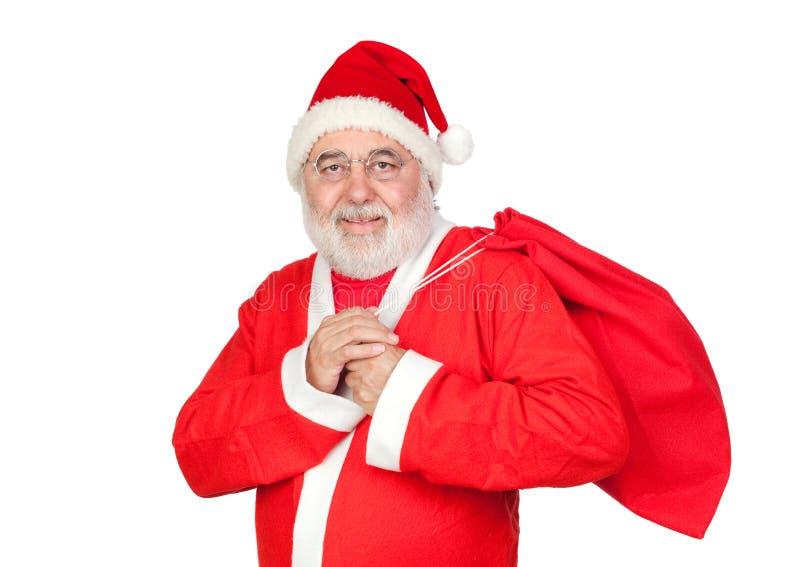 Weihnachtsmann mit einem vollen Sack lizenzfreie stockfotografie
