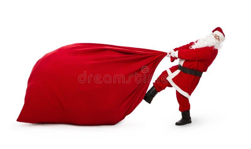 Weihnachtsmann mit enormer Tasche der Geschenke lizenzfreie stockfotografie