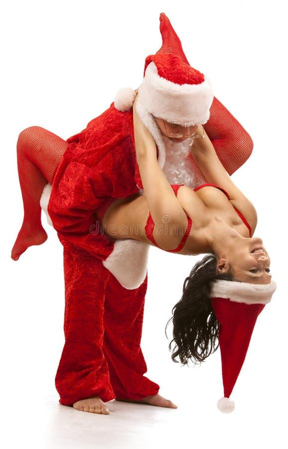 Weihnachtsmann mit reizvollem Mädchen stockbild