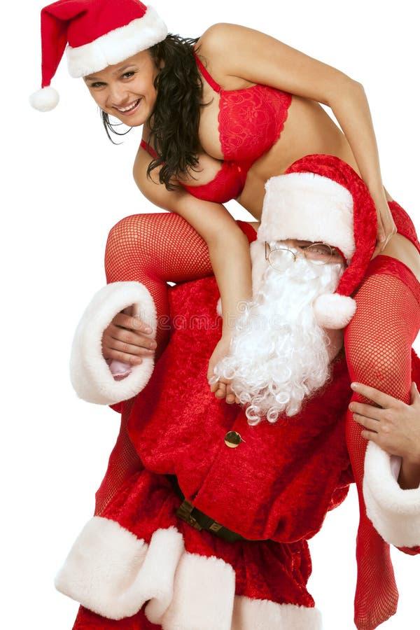 Weihnachtsmann mit reizvollem Mädchen lizenzfreies stockbild