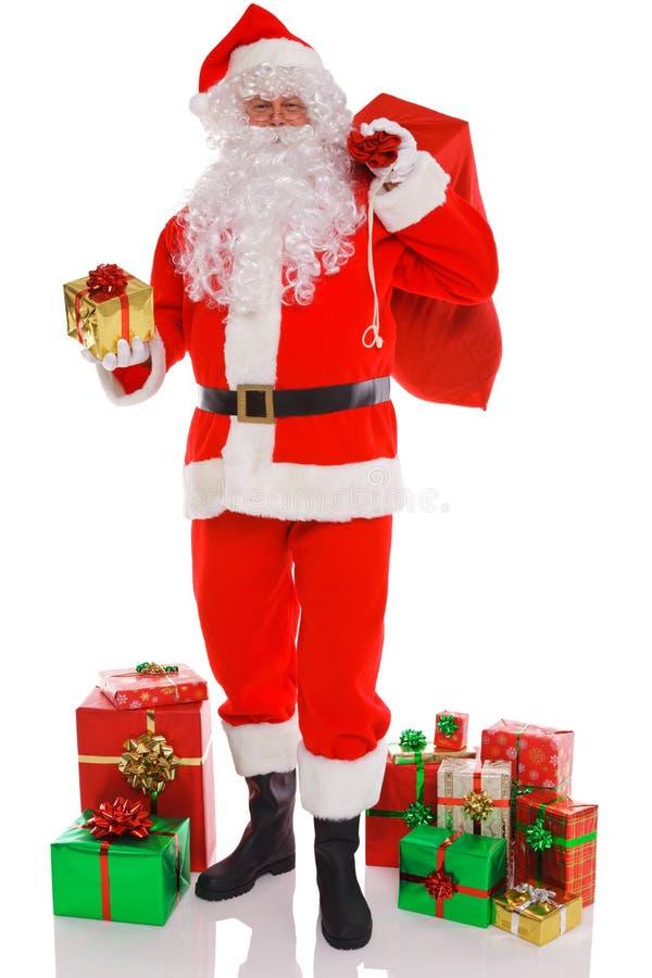 Weihnachtsmann mit Sack Geschenken stockbild