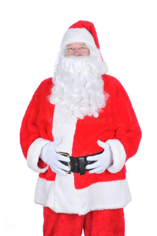 Weihnachtsmann mit seinen Händen auf Bauch stockfoto