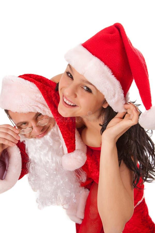 Weihnachtsmann mit sexy Mädchen lizenzfreies stockfoto