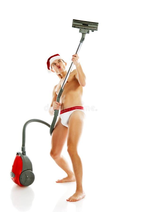 Weihnachtsmann mit Staubsauger lizenzfreie stockfotos