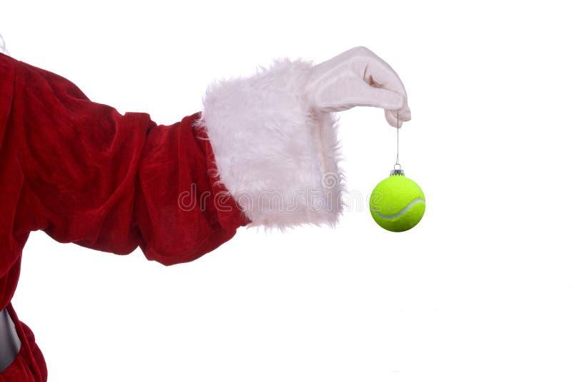 Weihnachtsmann mit Tennisverzierung stockfotos