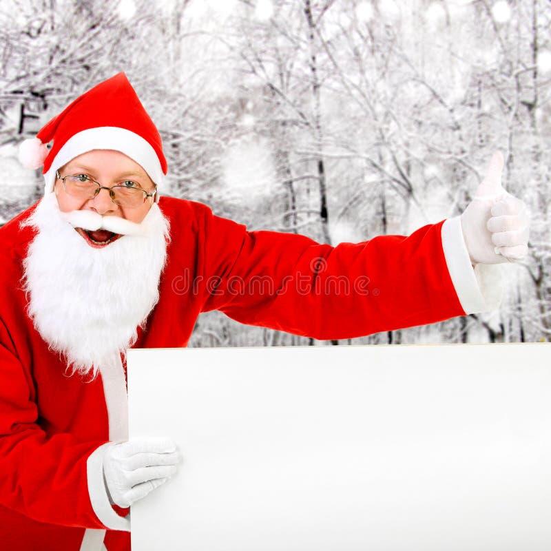 Weihnachtsmann mit unbelegtem Vorstand lizenzfreies stockfoto